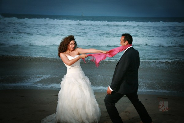 Trash the beach session at Venice Beach, CA with bride and groom